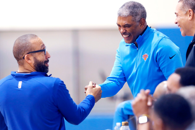 knicks-head-coach-david-fizdale-left-shakes-hands-with-new-york-knicks-president-steve-mills-while-speaking-to-new-york-knicks-gm-scott-perry-earlier-this-season.